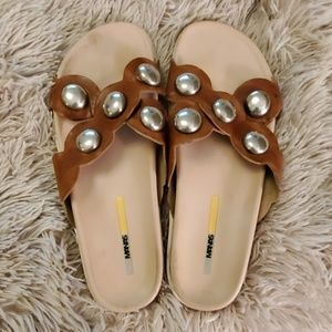 Light brown Manas sandals with silver accents